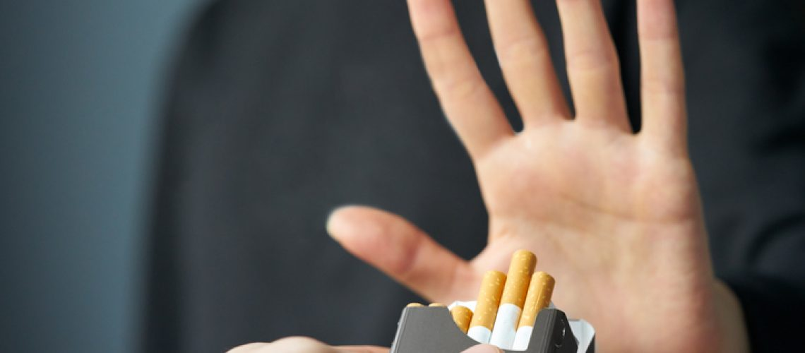 Quitting smoking concept. Hand is refusing cigarette offer
